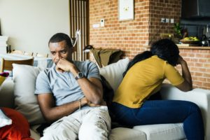 Black couple fighting and depressed